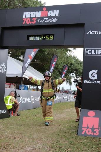Firefighter completing Iron Man Challenge